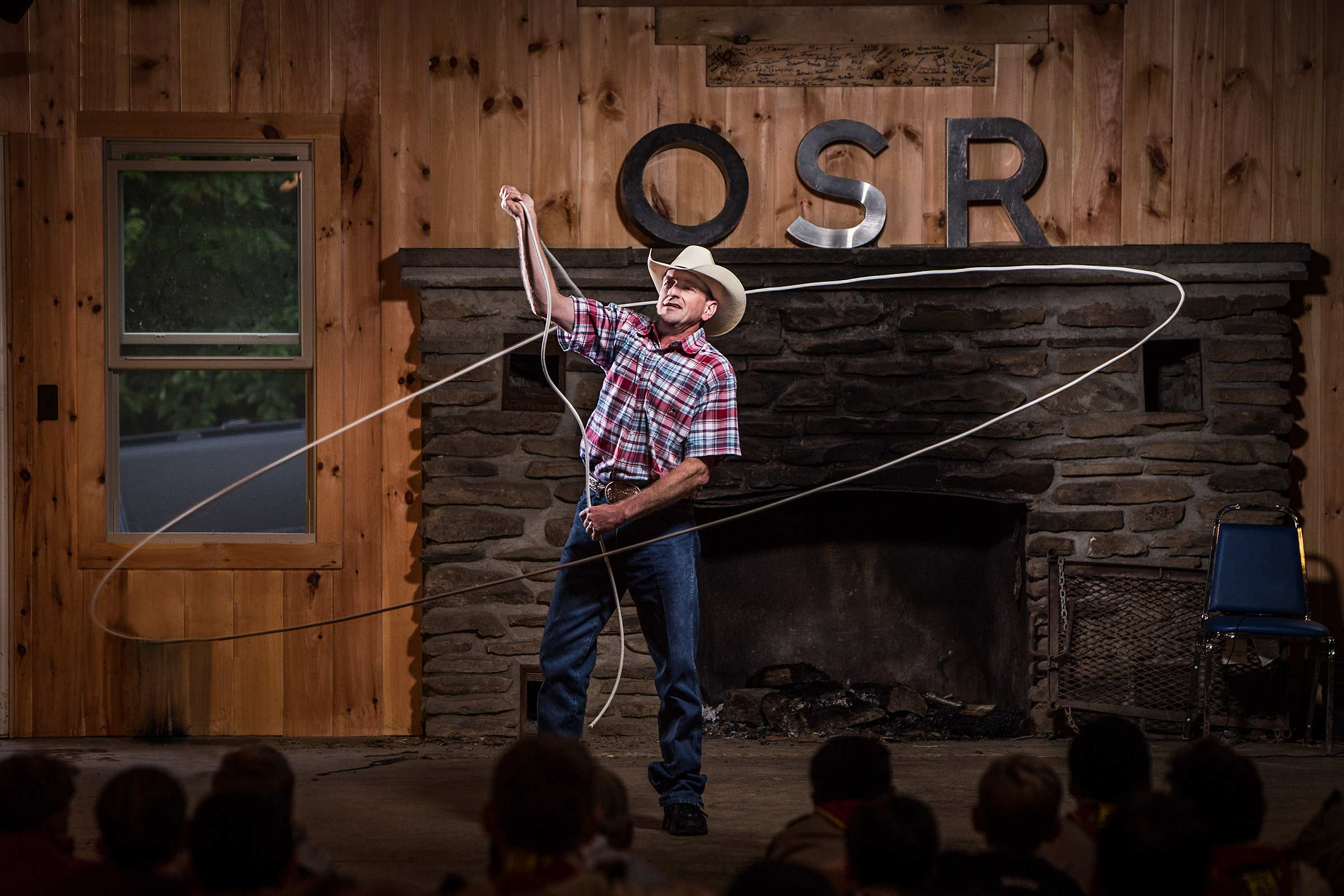 professional rope wrangler twirling rope overhead at boyscout camp in New York