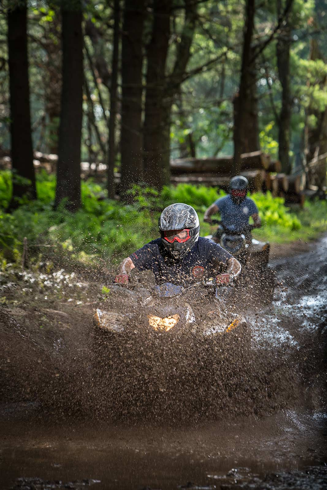 Teenage boyscouts riding ATV