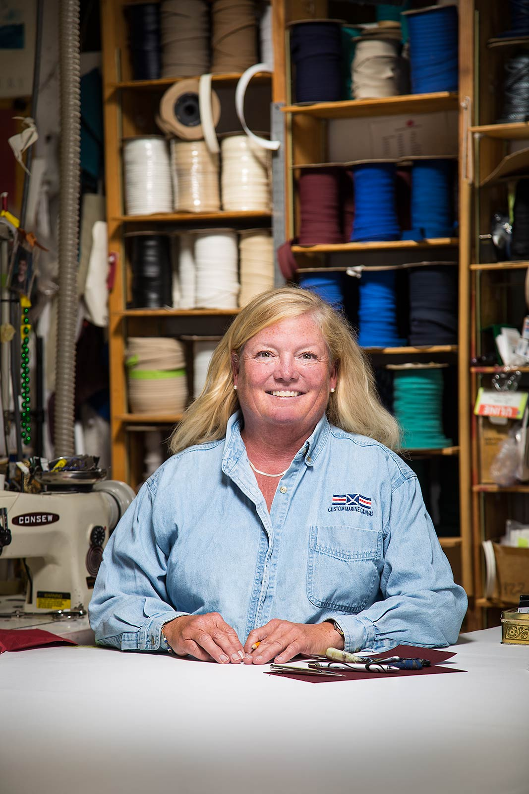 Portrait of small textile buisness owner at work