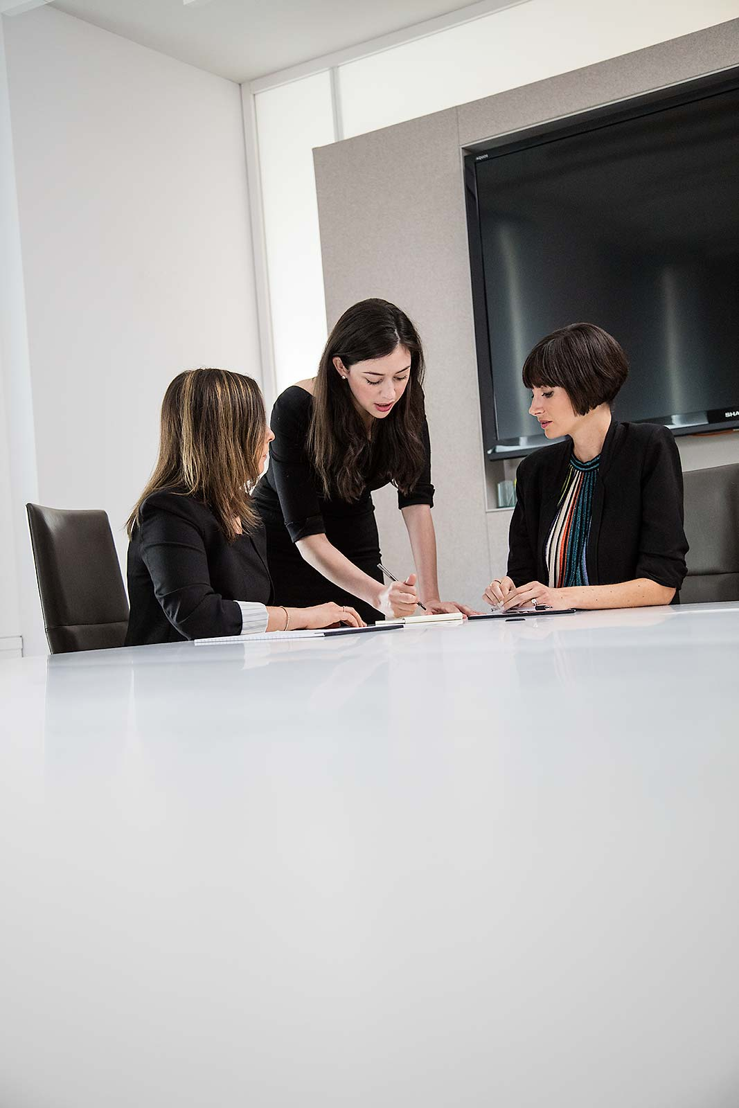 A team of female executives meeting in a New York City office