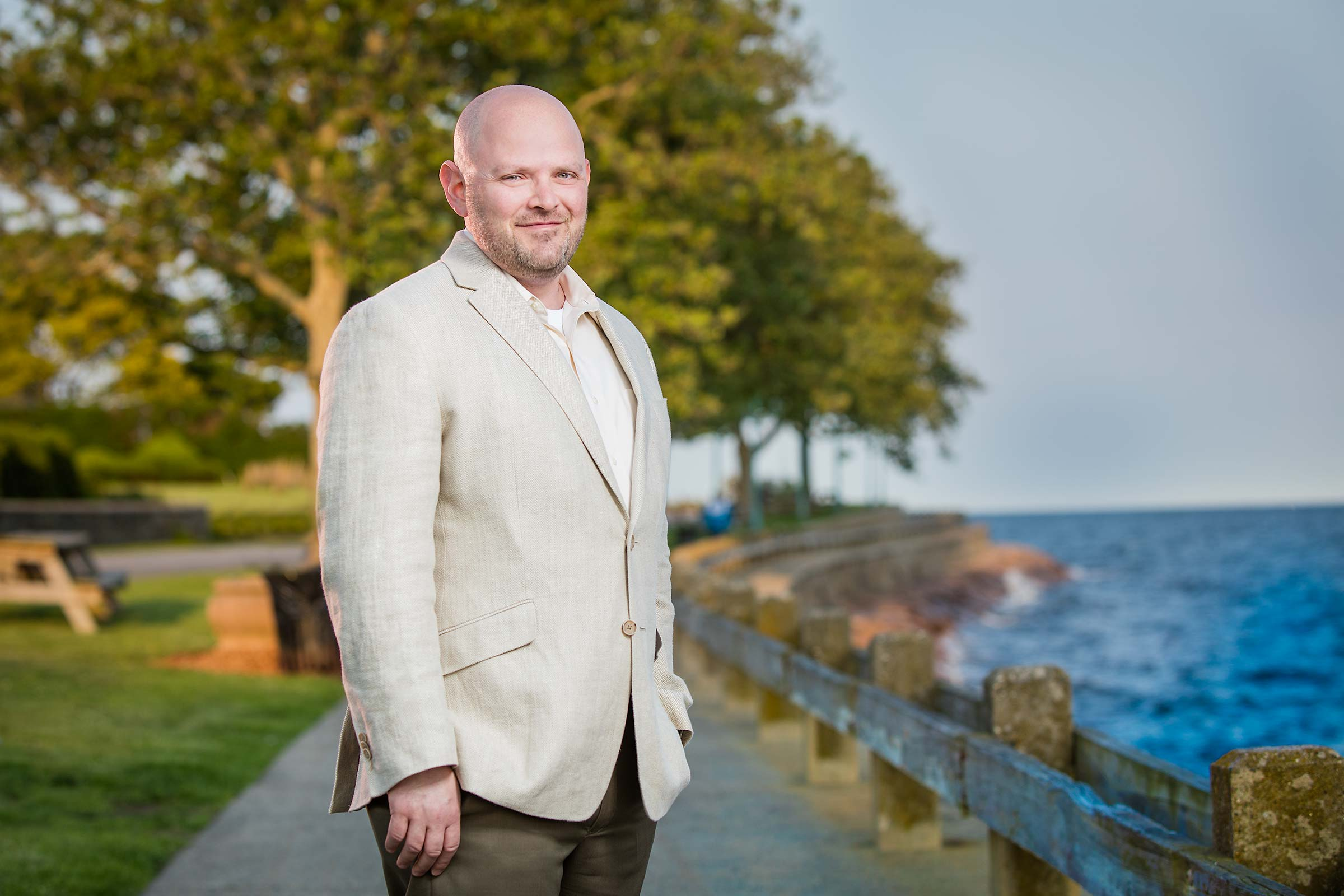 Casual outdoor portrait of municipal Technology Director near ocean in Connecticut