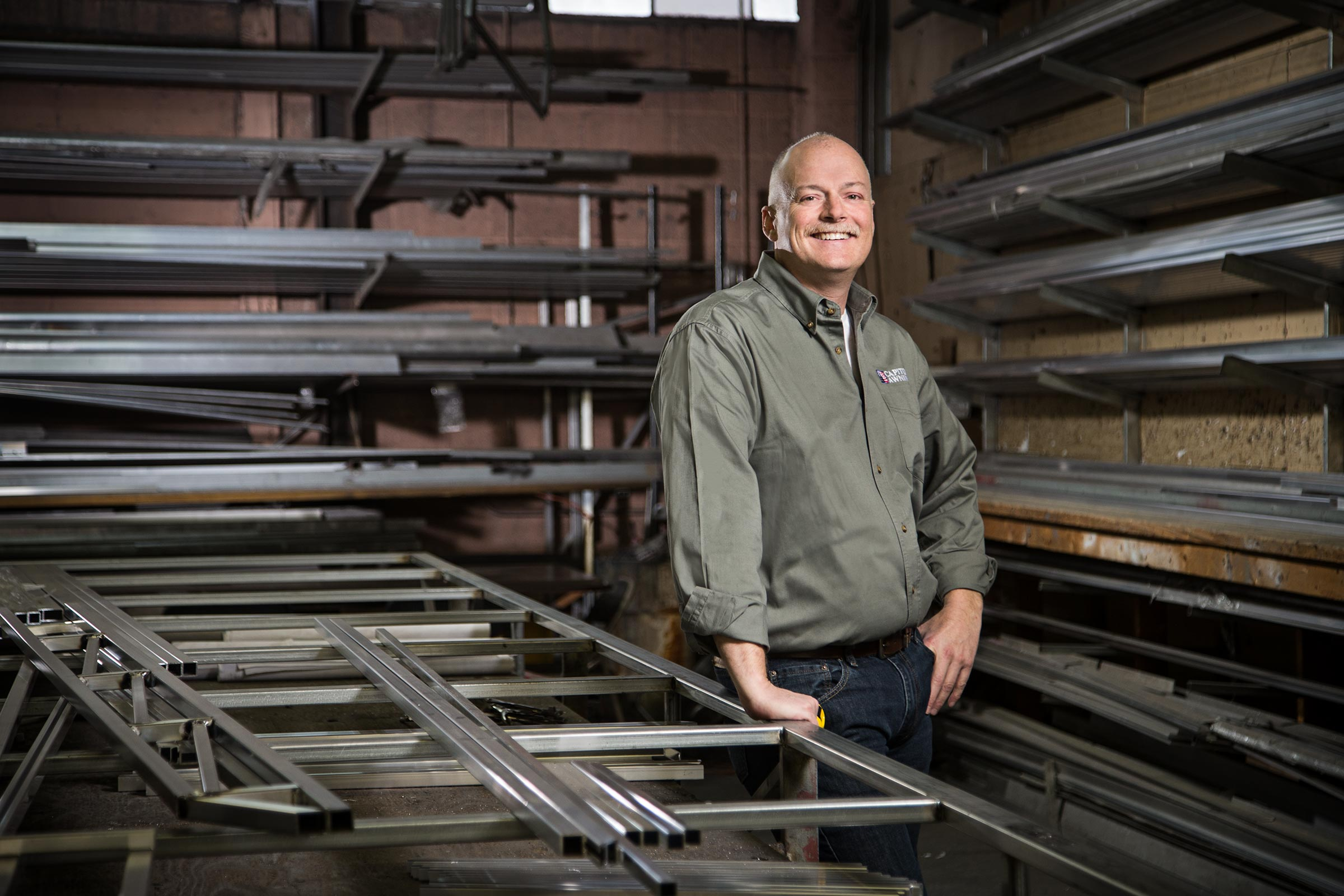 Small business owner surronded by steel in workshop in Queens, New York
