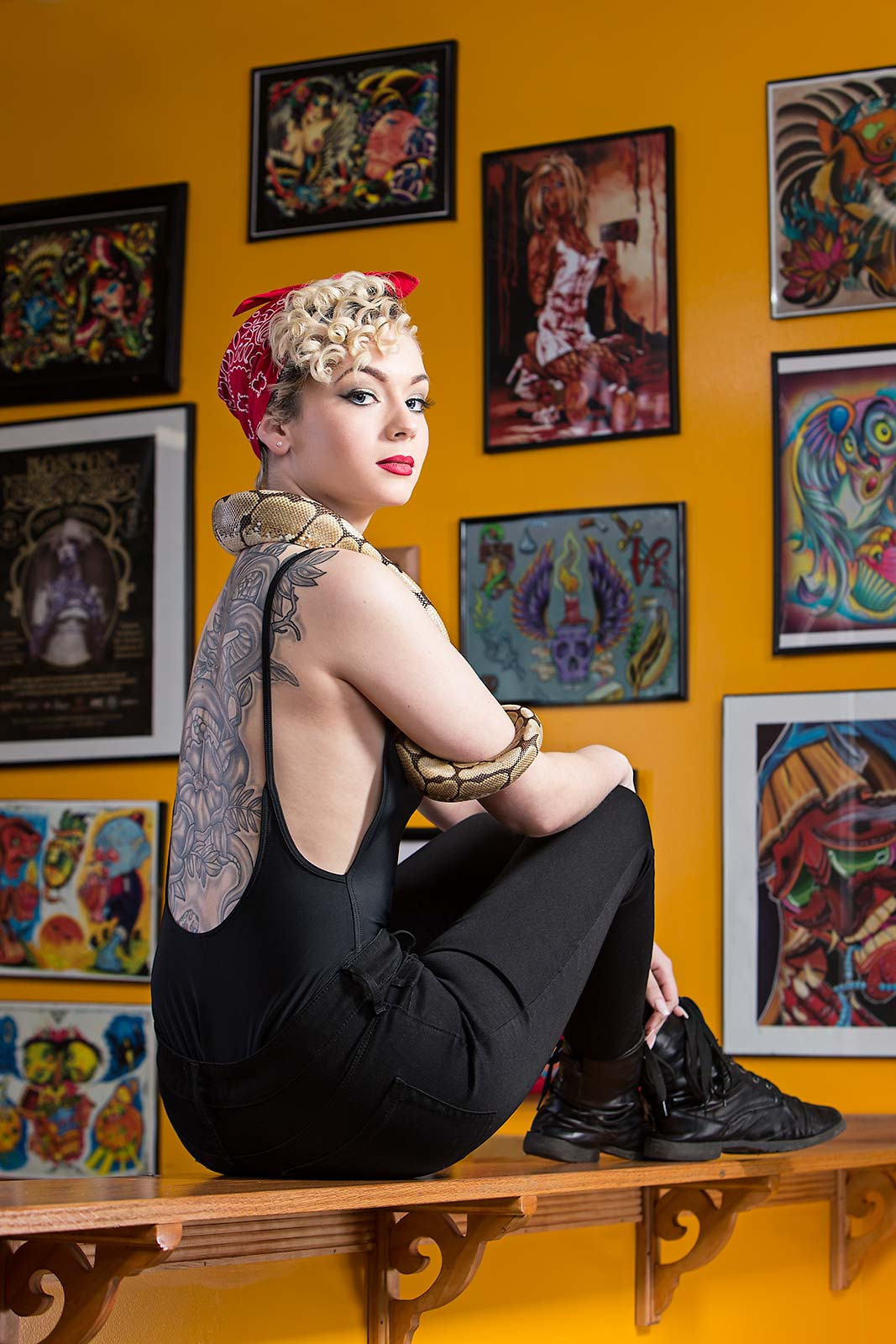 A young woman shows off her tattoos at a tattoo studio in Massachusetts