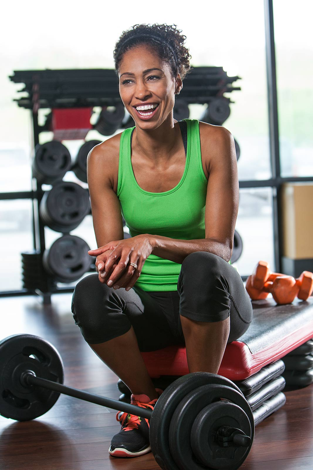 Smiling energetic portrait of ESPN on air talent Sage Steele in Connecticut gym