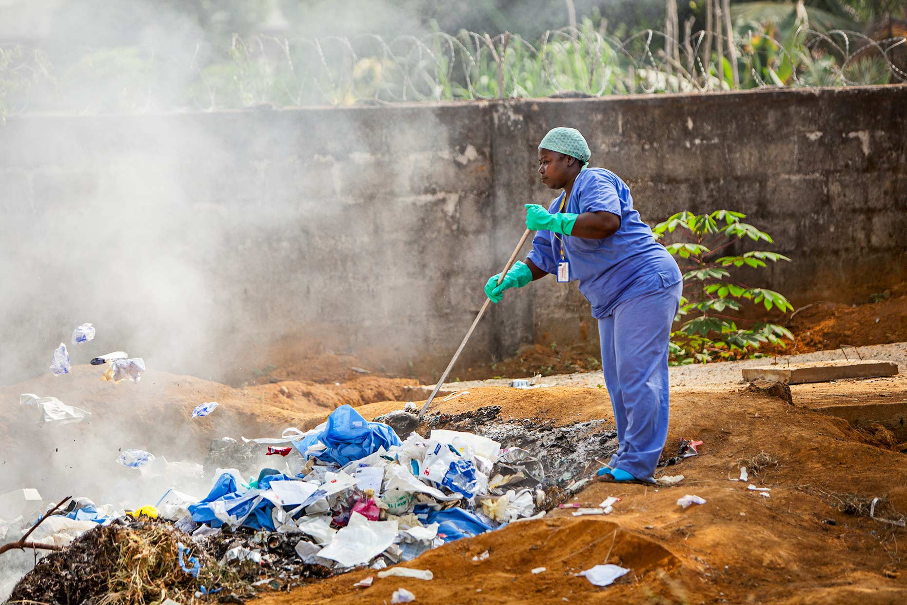 Contaminated PPE is burned next to an Ebola Treatment Unit