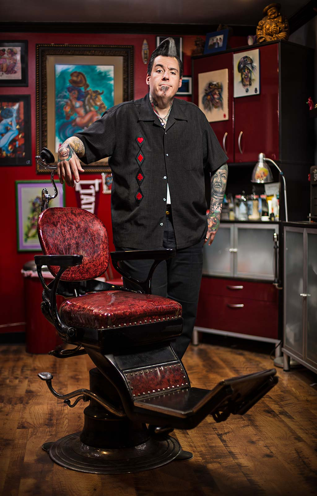 A celebrity tattoo artist poses in his studio in New Haven, Connecticut