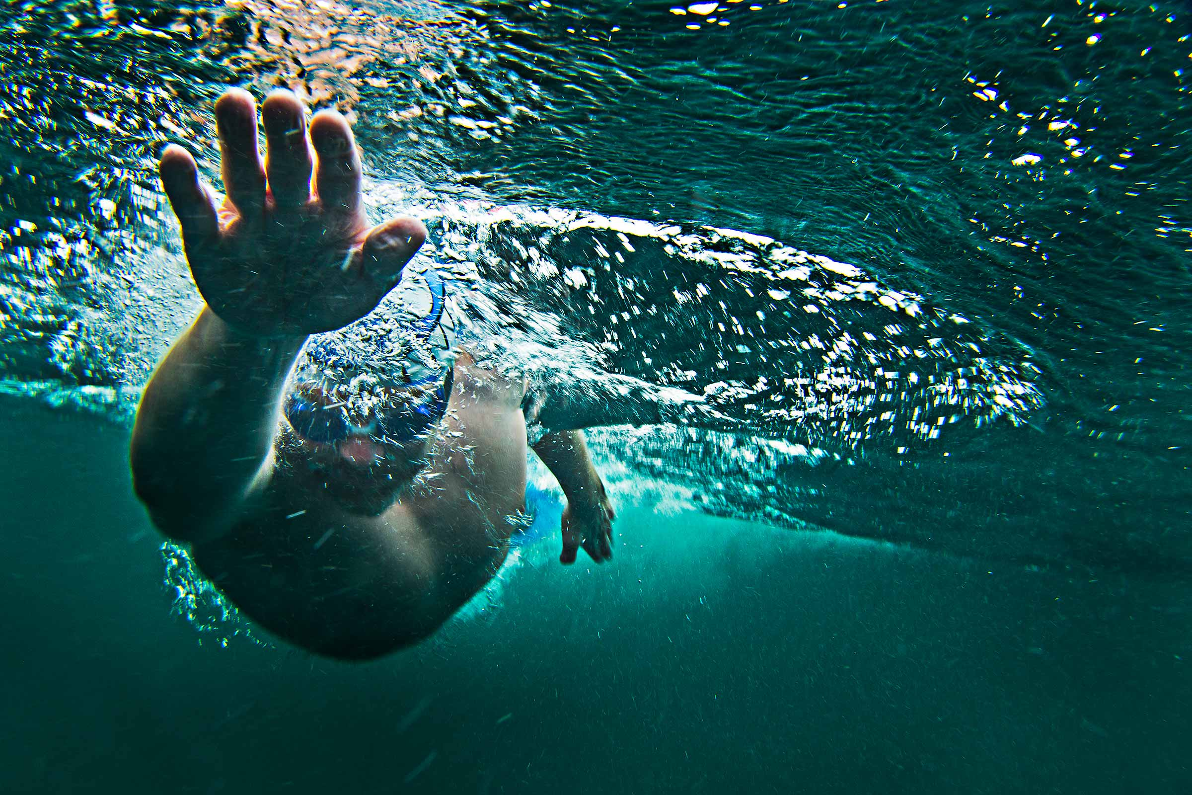 underwater action shot of long distance open water swimmer in Scotland