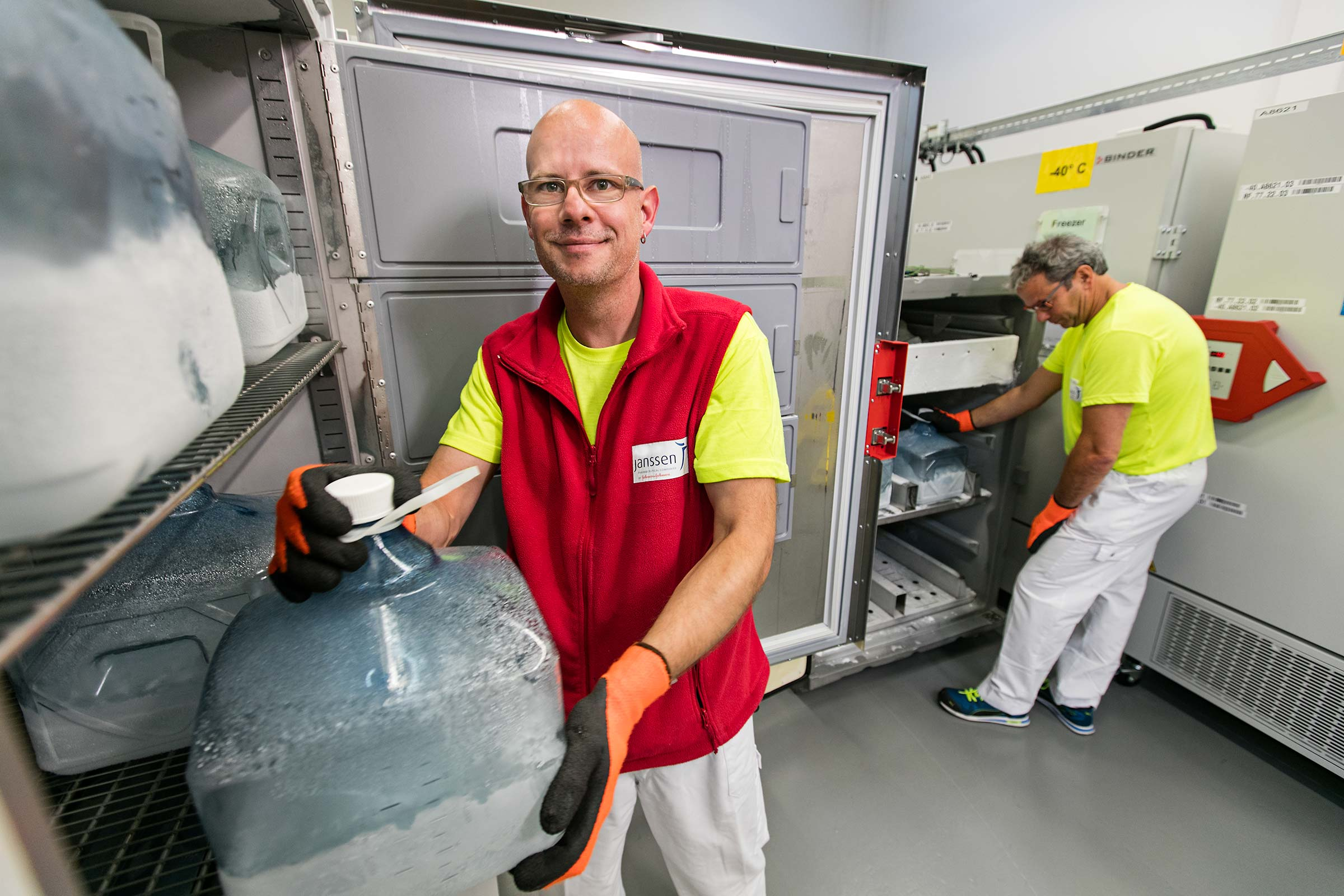Pharmaceutical manufacturing employees working in freezer in Switzerland