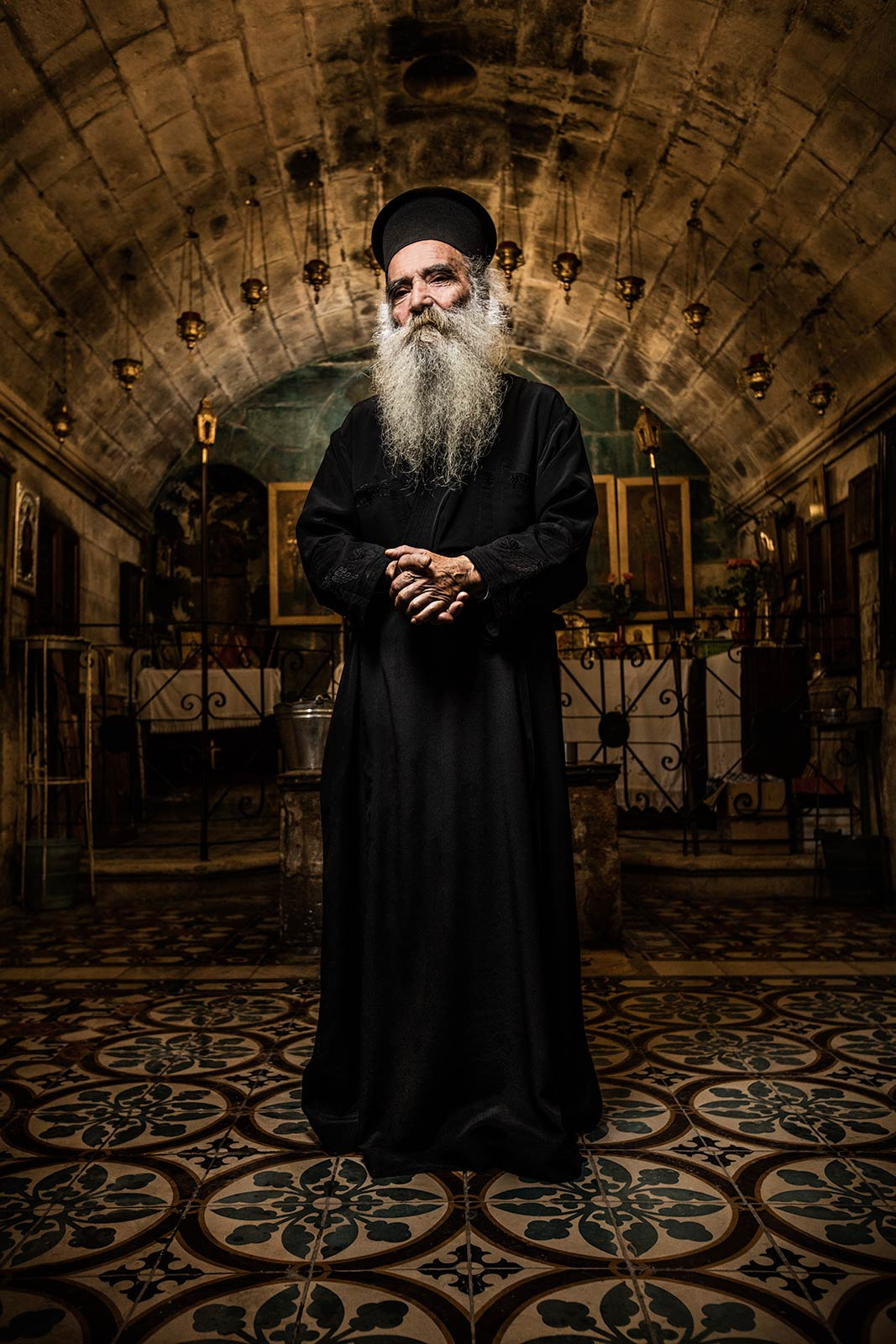 A dramatic moody portrait of a Greek Orthodox priest in Israel