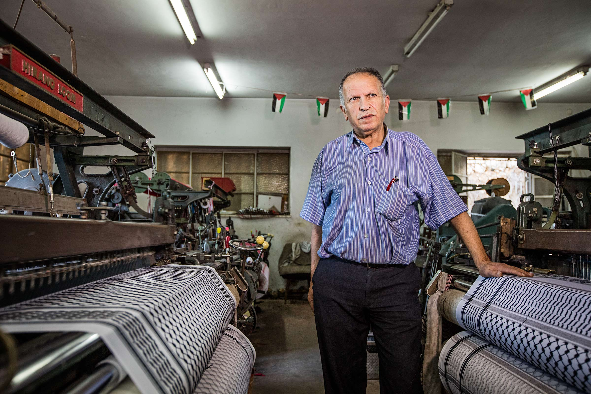 Portrait of a small business owner in his workshop in Palestine