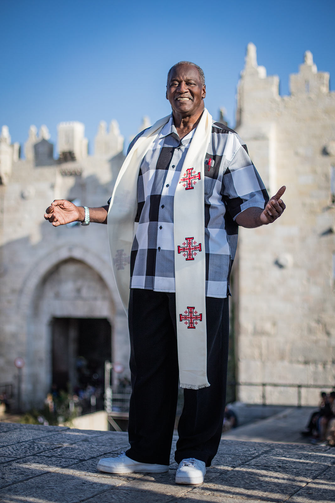 An African American reverend with his hands up in praise in Jerusalem