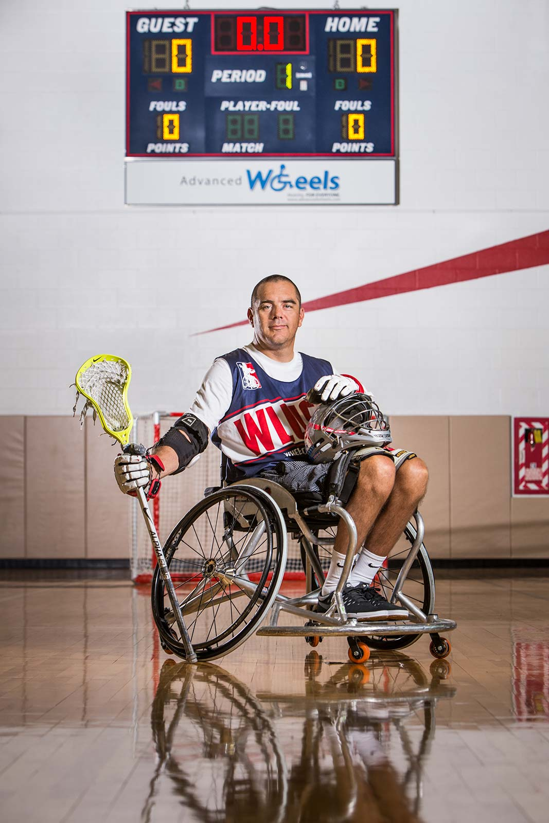 graphic portrait of advocate for disabled athletes posing in wheelchair with lacrosse stick