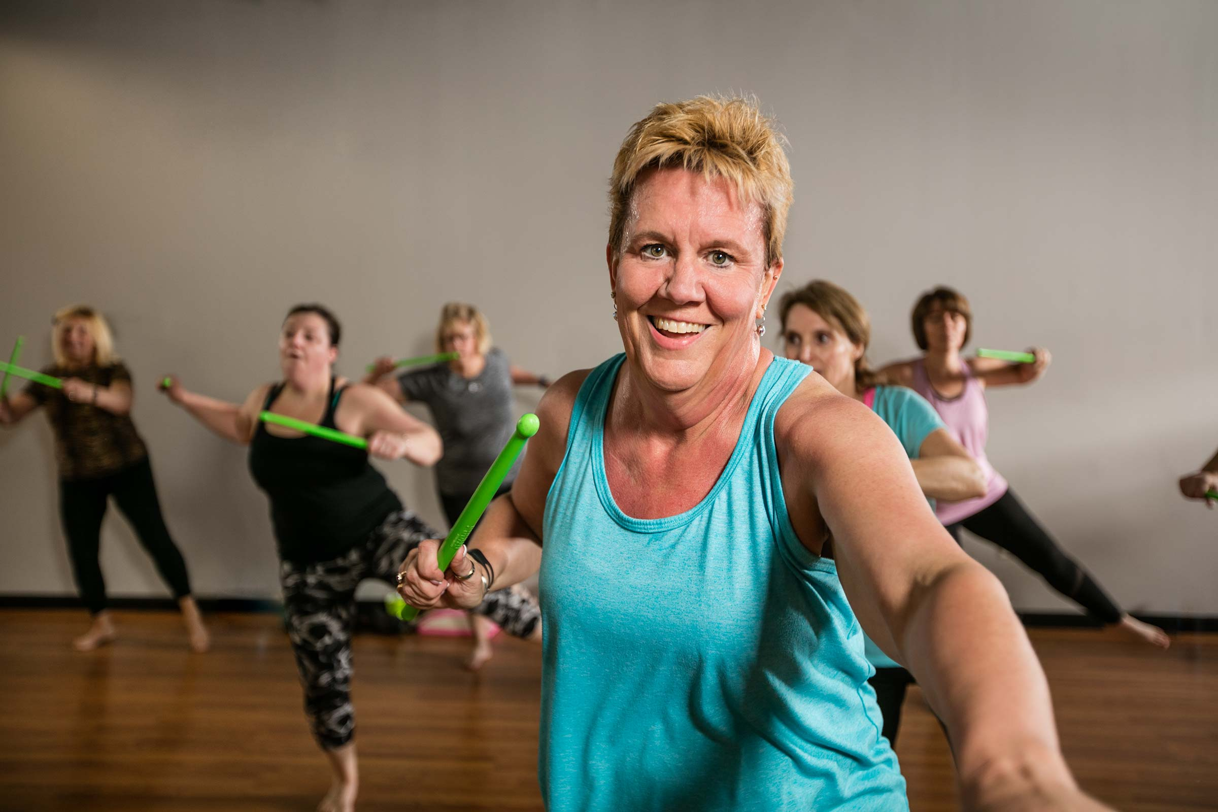 action shot of smiling older woman enagaged in healthy workout