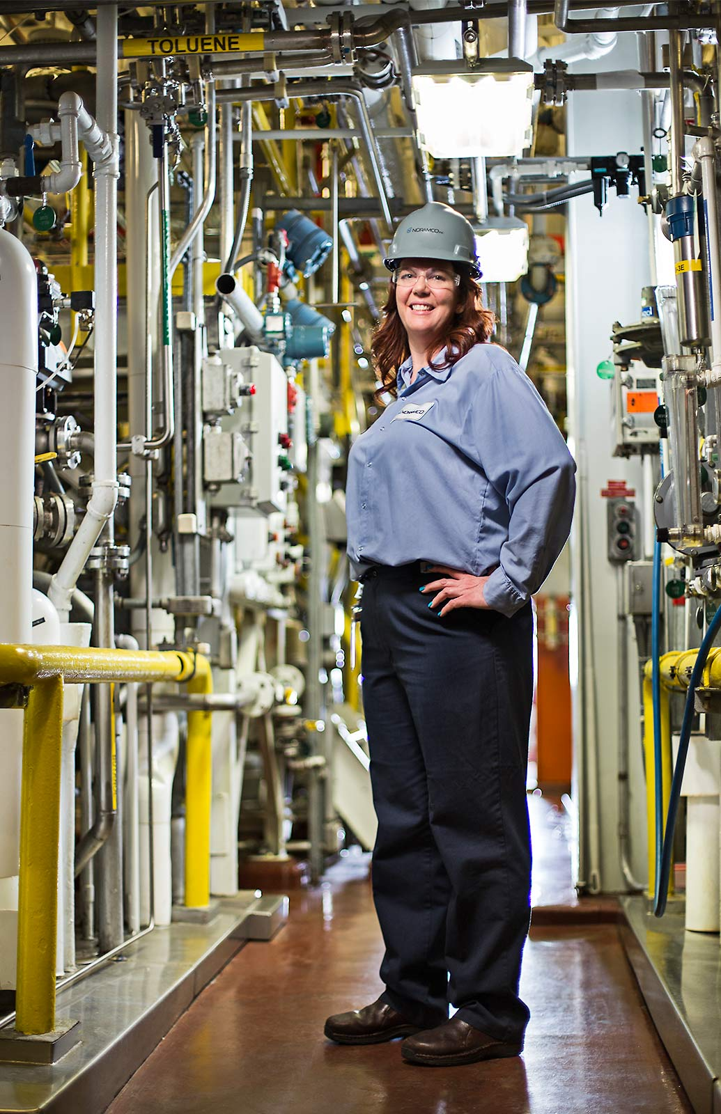Location Portrait of female worker in industrial faciltiy in the United States