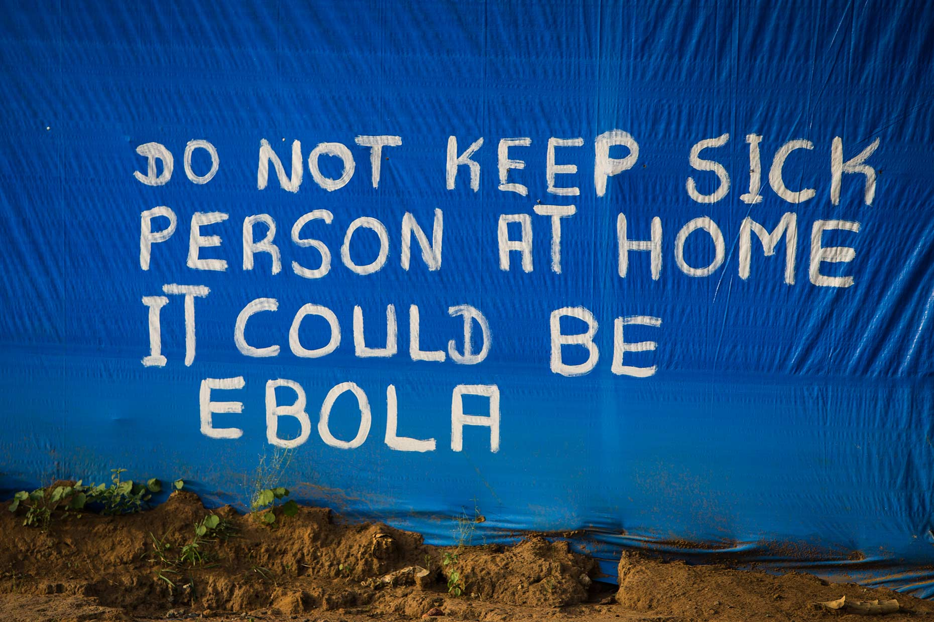 Hand painted warning of the dangers of the Ebola virus in Liberia