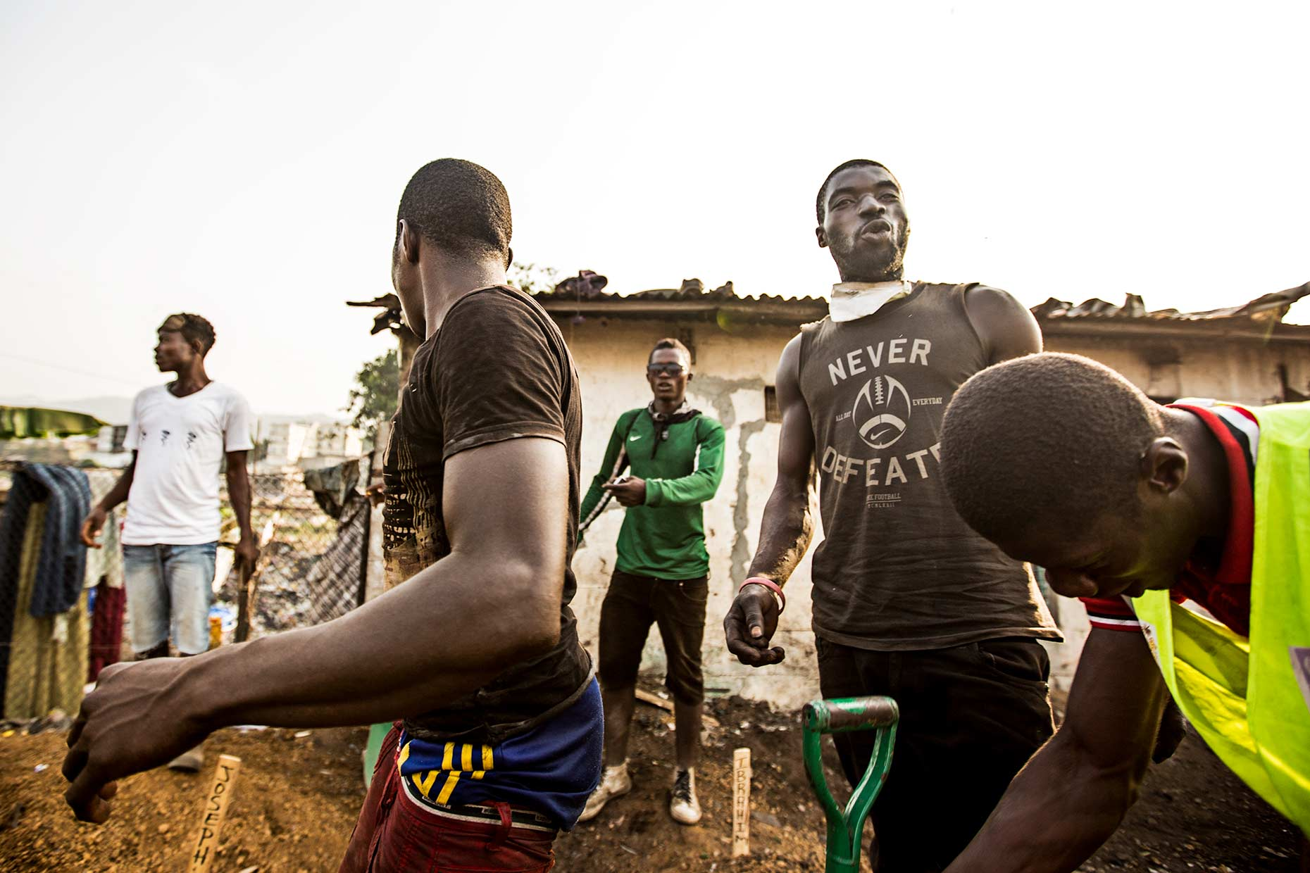 A group of workers in a heavily contaminated Ebola Graveyard