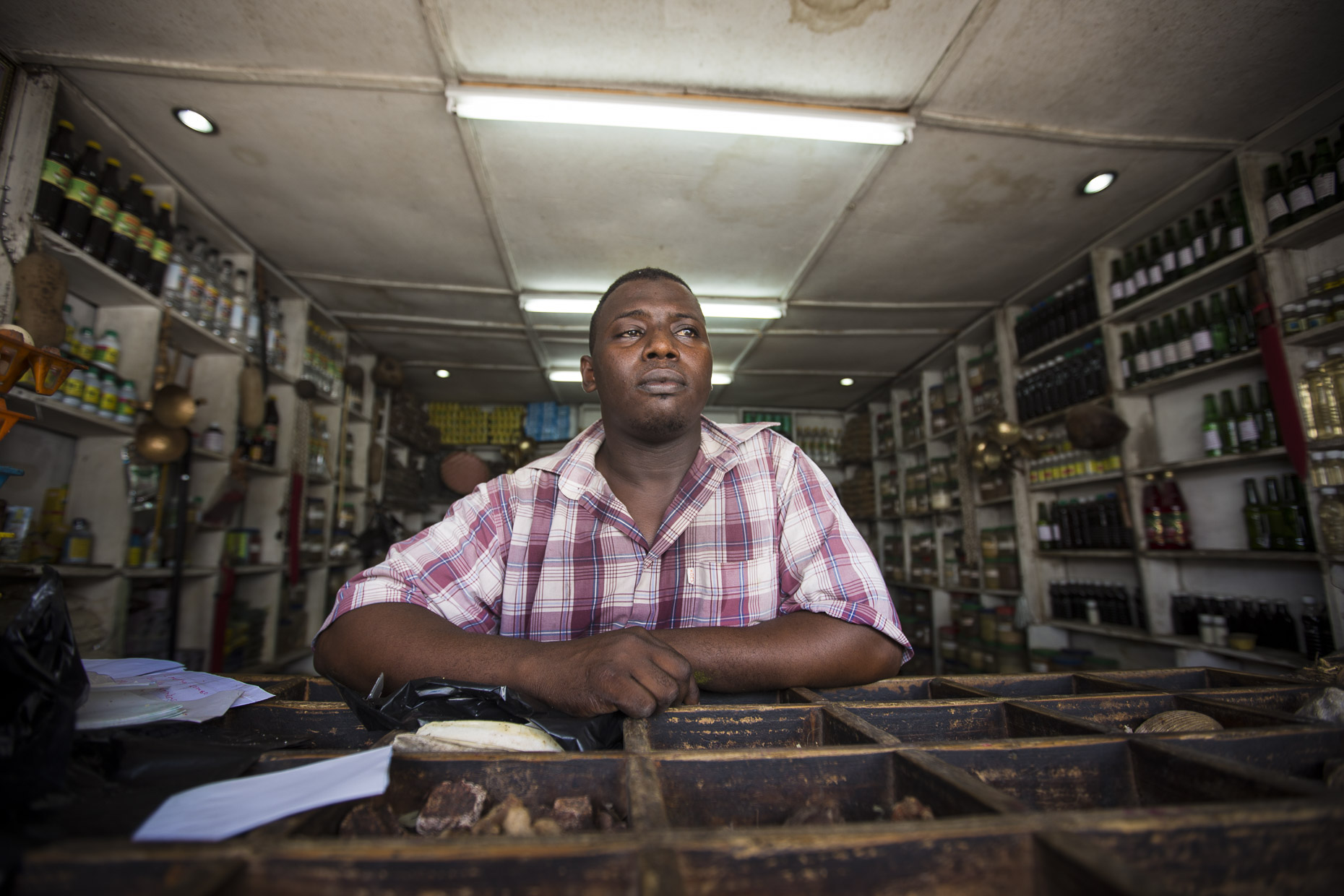 Portrait of an East African shop owner who trades is goods used for Witchcraft