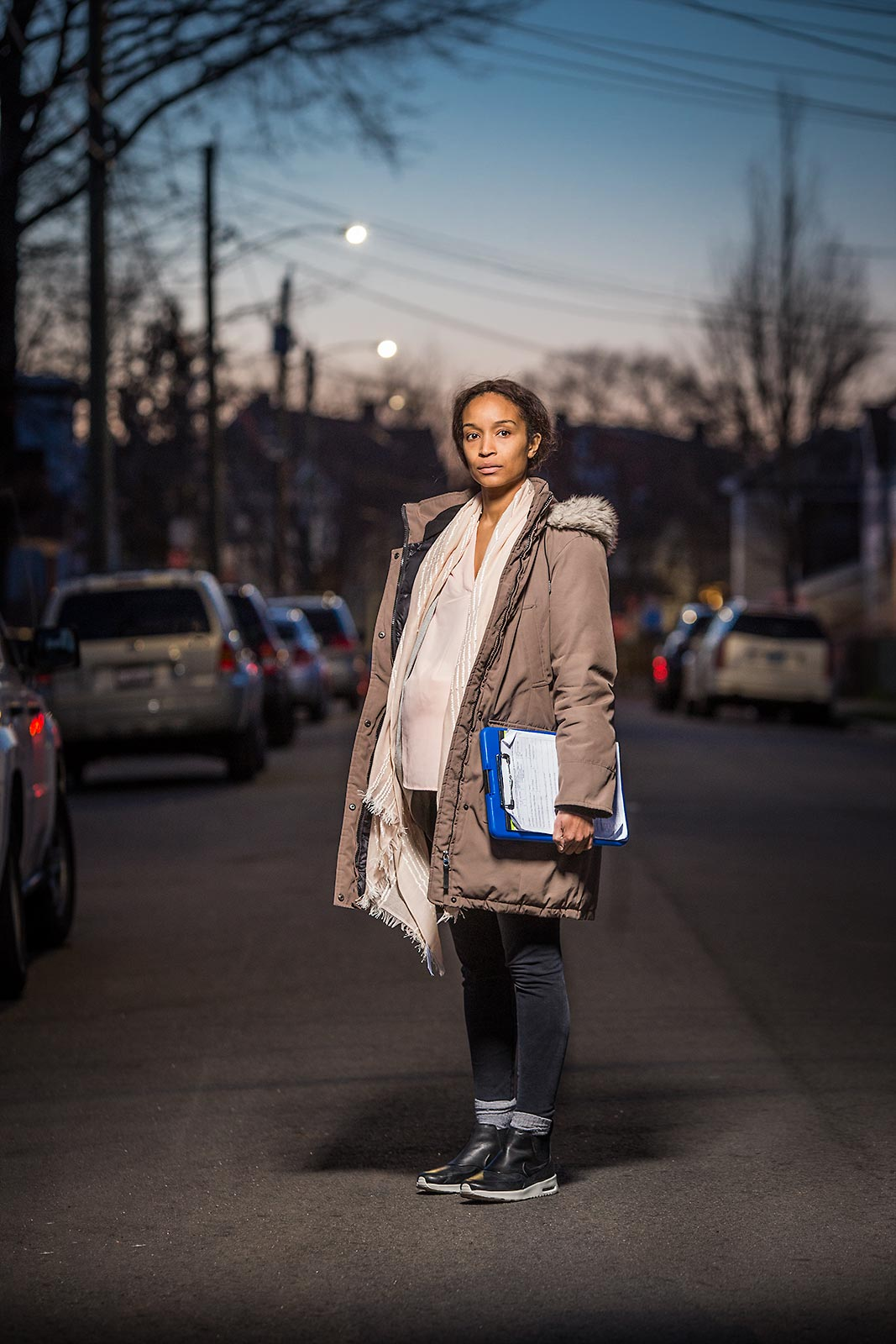 Night portrait of a pregnant African American social worker in Connecticut